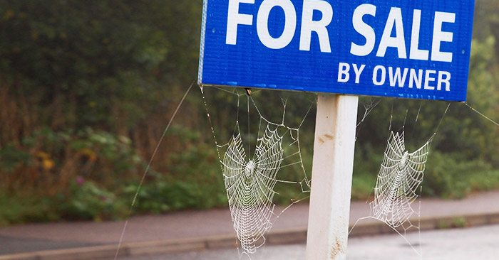 for sale by owner sign with cobwebs